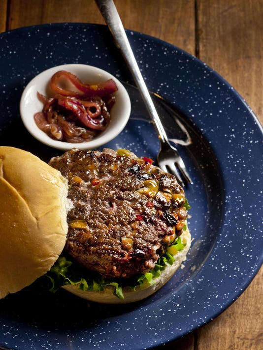 Dress up bison burgers with olives, sun-dried tomatoes and a glass of wine