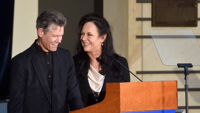 Randy Travis and his wife, Mary Davis-Travis, speak after he was announced as the next inductee into the Country Music Hall of Fame on March 29, 2016, in Nashville.