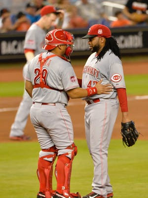 Cincinnati Reds catcher Brayan Pena (L) talks with starting pitcher Johnny Cueto (R) on the mound during the fourth inning against the Miami Marlins at Marlins Park.