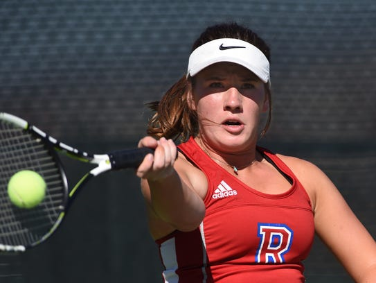 Reno's Jil Rovetti hits a forehand return to opponents