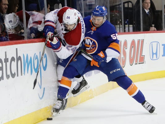 New York Islanders' Tanner Fritz (56) checks Montreal Canadiens' Phillip Danault (24) during the first period of an NHL hockey game Friday, March 2, 2018, in New York. (AP Photo/Frank Franklin II)