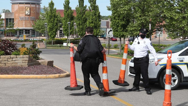 Summit Mall security officers close the main entrance to Summit Mall on Monday June 1, 2020 in Fairlawn, Ohio.