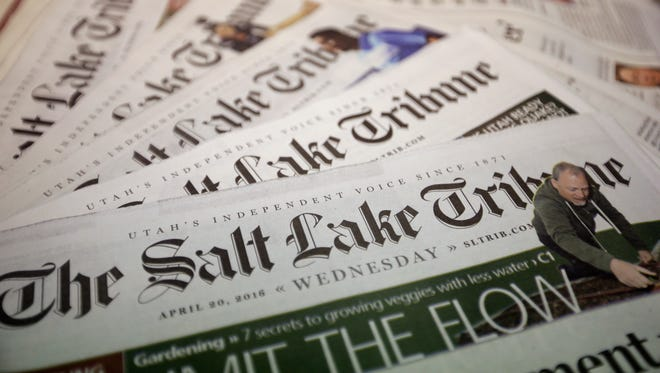 The Salt Lake Tribune is shown Wednesday, April 20, 2016, in Salt Lake City. A son of wealthy industrialist Jon Huntsman Sr. has agreed to buy The Salt Lake Tribune, ending uncertainty about the future of Utah's largest independent newspaper. Digital First Media announced in a news release Wednesday that the company reached an agreement to sell the newspaper to Paul Huntsman. Terms of the deal weren't disclosed.