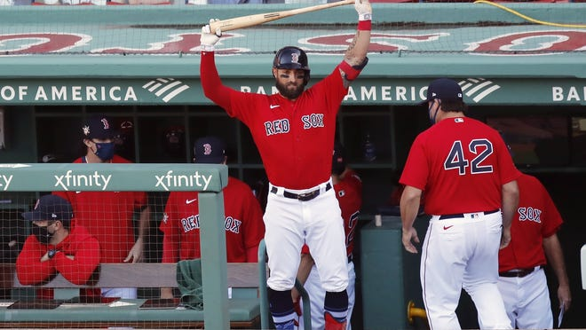 The Boston Red Sox's Kevin Pillar stretches in the dugout during the eighth inning of Sunday's game against the Washington Nationals, in Boston. The Red Sox traded Pillar to the Colorado Rockies on Monday, Aug. 31, 2020, for a player to be named later.