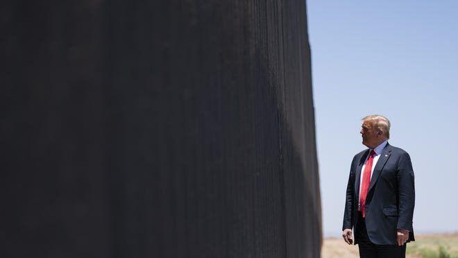 In this June 23  file photo, President Donald Trump tours a section of the border wall in San Luis, Ariz.