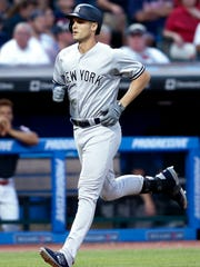 New York Yankees' Greg Bird rounds the bases after hitting a solo home run off Cleveland Indians starting pitcher Mike Clevinger during the sixth inning of a baseball game, Saturday, July 14, 2018, in Cleveland.