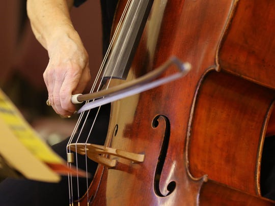 Cellist, E. Zoe Hassman playing one of her many selections in Monday morning's concert.