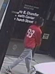 Another view of the man New Brunswick police are looking to identify in connection with a purse snatch and robbery last month.