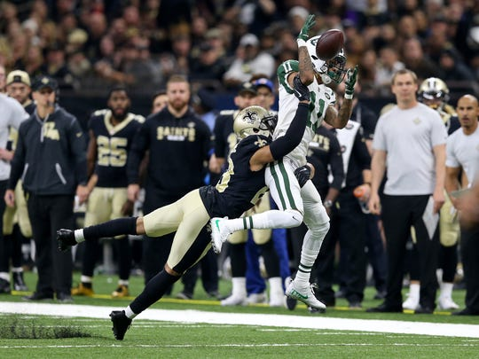 New Orleans Saints cornerback Marshon Lattimore (23) breaks up a pass intended for New York Jets wide receiver Robby Anderson (11) in the first quarter of the game at the Mercedes-Benz Superdome.