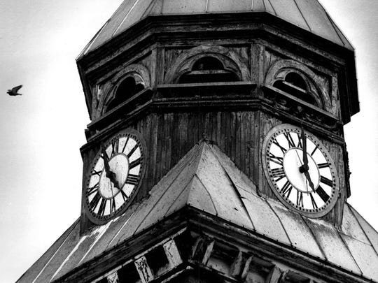 The south tower of Holy Redeemer Church is seen in this 1989 file photo. Pigeons were able to get into the towers; they gathered just above the clocks.