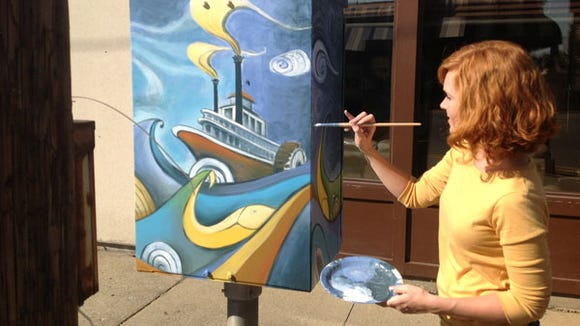 One of the electric boxes in Jeffersonville painted by a commissioned artist.
