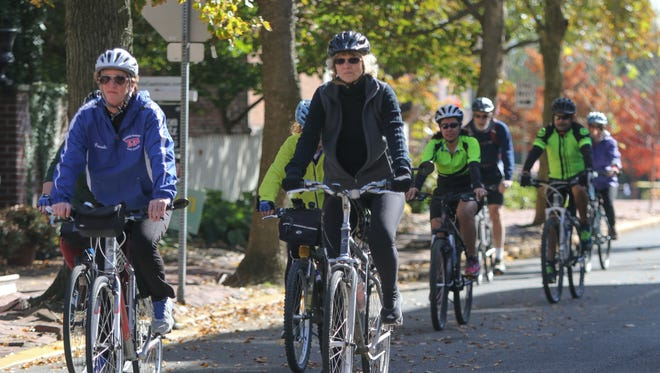 Cyclists ride from New Castle to Delaware City in the River Towns Ride and Festival on Saturday.