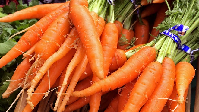 Early-season carrots from Mr. Harvest in Grand Isle for sale at the Essex Five Corners Market.