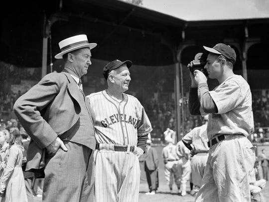 Cincinnati Reds' pitcher Johnny Vander Meer winds up his movie camera for a shot of Grover Cleveland Alexander, left, former pitching star, and Tris Speaker, famous outfielder, as they gathered for an exhibition game which marked the centennial anniversary of baseball at Cooperstown, N.Y., June 12, 1939.