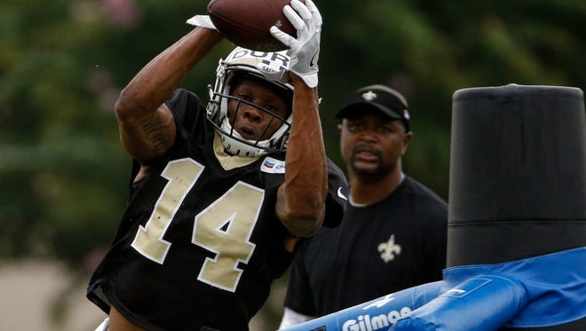 Jul 29, 2017; Metairie, LA, USA; New Orleans Saints wide receiver Travin Dural (14) catches a pass during training camp at the Metairie Training Facility. Mandatory Credit: Derick E. Hingle-USA TODAY Sports