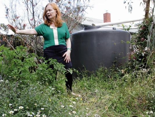 Helen Nippard talks about how her family has conserved water and installed two rain collection tanks on her property in Melbourne.