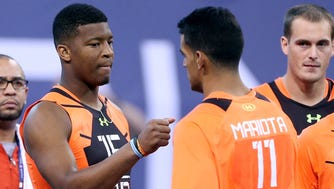 Jameis Winston, left, and Marcus Mariota shared the combine stage. But will they skip the draft stage?