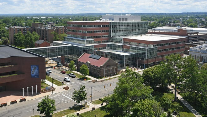 The Erie Insurance headquarters, at left, and its still-under-construction office building, at right, located just east of Perry Square in downtown Erie, is shown on June 19.