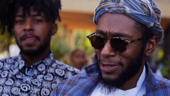 Yasiin Bey, formerly known as Mos Def, right, moved to South Africa to escape racism in 2016.