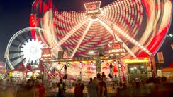 Lights from rides at the Arizona State Fair leave trails