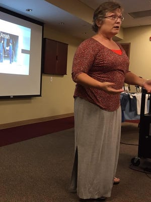 """Brenda Nixon, author and self-described """"mom to the ex-Amish,"""" talks about young Amish people she has known, Tuesday at the Bucyrus Public Library."""