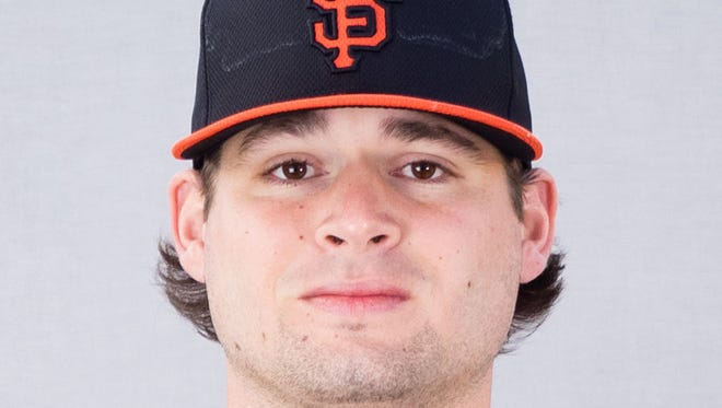 Feb 27, 2015: San Francisco Giants pitcher Cody Hall (59) poses for a photo during photo day at Scottsdale Stadium.