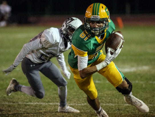 Coachella Valley's Ruben Sanchez completes a pass and