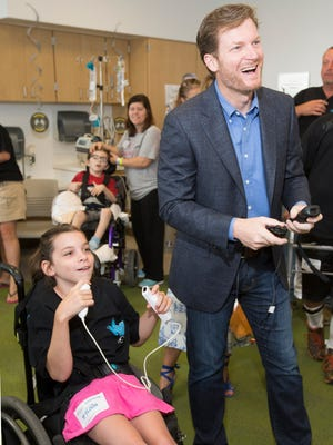 Dale Earnhardt Jr. plays Wii boxing with Maddie Delaney, 10, during a tour of the Nationwide Children's Hospital in Columbus, Ohio.
