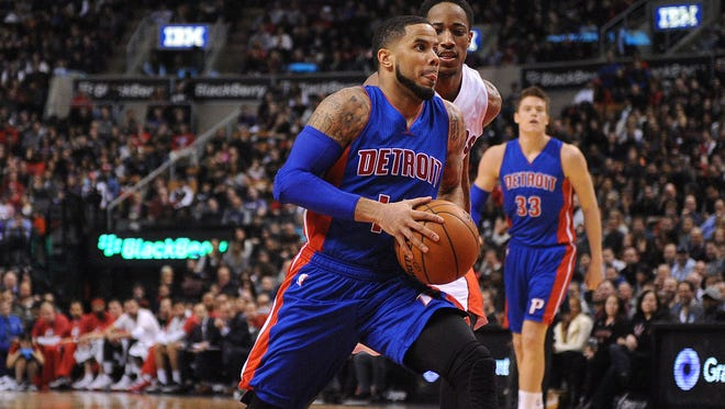 Pistons guard D.J. Augustin (14) moves under the basket to shoot as Toronto Raptors guard DeMar DeRozan (10) moves to defend in the second quarter at Air Canada Centre.