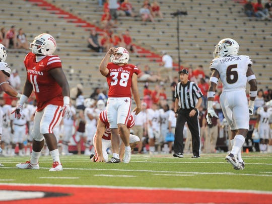 Calvin Linden (38), shown here kicking as a backup against UL Monroe last season, has competition for the starting job this season.