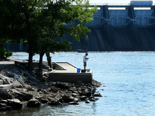 A fisherman on one of the docks just below the Fort Loudoun dam in Lenoir City on June 18, 2018. Two anglers were injured after their boat capsized near the dam on Monday.