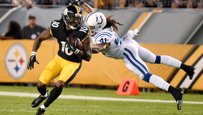 Indianapolis Colts defensive back Matthias Farley (41) dives to get to Pittsburgh Steelers wide receiver Martavis Bryant (10) during the first half of an NFL preseason football game, Saturday, Aug. 26, 2017, in Pittsburgh.