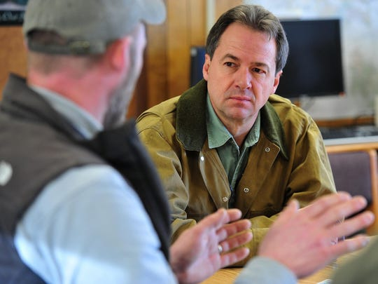 Gov. Steve Bullock talks with Fish, Wildlife and Parks biologist Jay Kolbe about FWP's pilot shoulder season elk hunt that took place on block management areas around White Sulphur Springs.