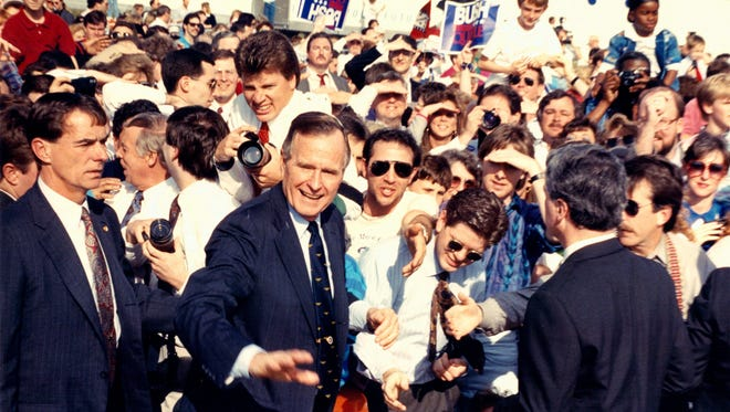 March 5, 1992 - President George H.W. Bush plunges into a crowd after speaking to about 3,500 people at Memphis International Airport. It was Bush's second campaign trip to Tennessee for Tuesday's primary.