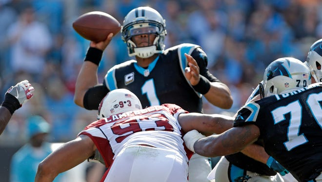 Arizona Cardinals defensive end Calais Campbell (93) defends as Carolina Panthers' Cam Newton (1) looks to pass in the second half of an NFL football game in Charlotte, N.C., Sunday, Oct. 30, 2016.