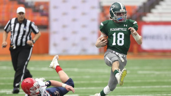 Pleasantville's Jack Howe (18) runs for a his third