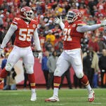 Kansas City outside linebacker Tamba Hali (91) celebrates with linebacker Dee Ford (55) after a sack against Oakland Sunday. The Chiefs defense will face a stiff test against Pittsburgh (9-5) in a game that will shape their playoff fate.