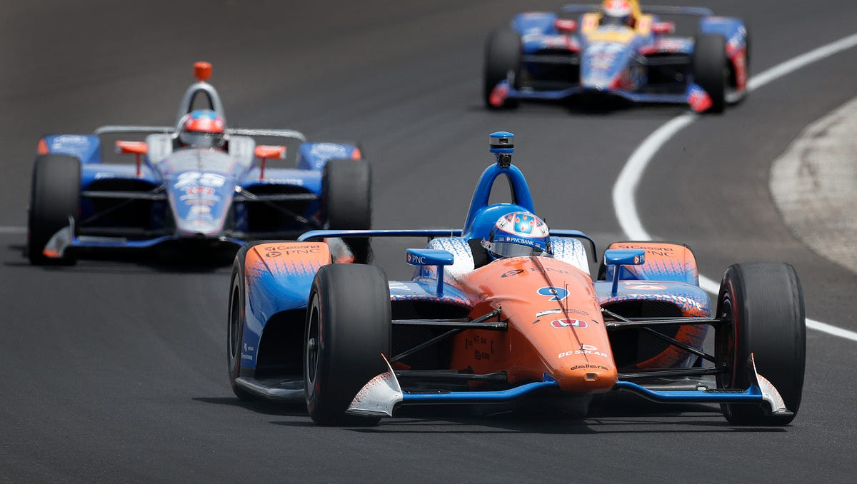 Chip Ganassi Racing IndyCar driver Scott Dixon (9) leads a group of cars through turn 3 during practice for the Indianapolis 500 at the Indianapolis Motor Speedway on Thursday, May 17, 2018.