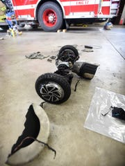 What remains of a hoverboard that caught fire while recharging lies in the garage of Fire Station No. 1.