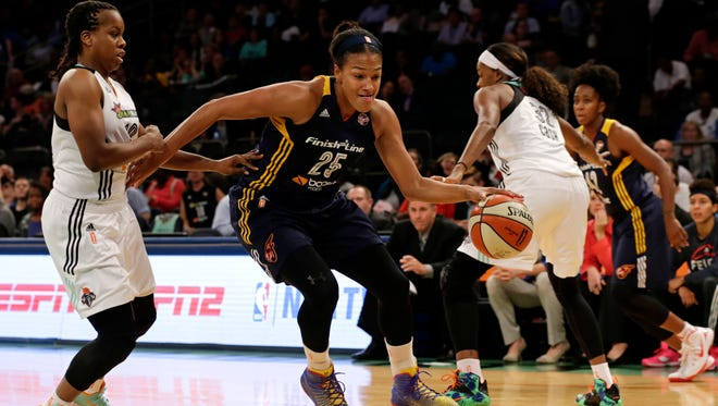 Indiana Fever guard Marissa Coleman (25) drives to the basket past New York Liberty guard Epiphanny Prince, left, during the first half in Game 3 of the WNBA basketball Eastern Conference finals at Madison Square Garden in New York, Tuesday, Sept. 29, 2015. (AP Photo/Adam Hunger)