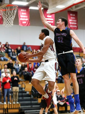 Fond du Lac High School boys basketball's Quintin Winterfeldt goes up for a basket against Germantown High School Saturday night, November 25, 2017. Fond du Lac won the game 72-49 to start the 2017 season 1-0. Doug Raflik/USA TODAY NETWORK-Wisconsin