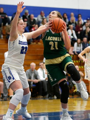 Laconia's Alissa Dins goes up for a basket against St. Mary's Springs' Emily Mueller during a Dec. 21 game.