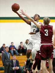 Laconia's Jaylen Mahone shoots a basket against Mayville's Emmit Hurtienne during a Feb. 16 game in Rosendale.