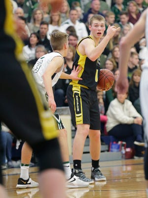 Waupun High School boys basketball's Marcus Domask directs another teamate during their game against Kettle Moraine Lutheran Saturday March 10, 2018 at the WIAA Division 3 sectional finals game in Whitefish Bay. KML won the game 53-48. Doug Raflik/USA TODAY NETWORK-Wisconsin
