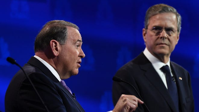 Republican presidential candidates Mike Huckabee and Jeb Bush during the CNBC Republican presidential debate on Oct. 28, 2015, in Boulder, Colo.