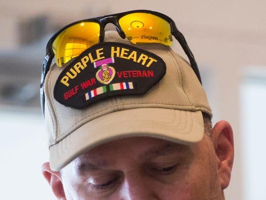 Veteran Daniel Belcher speaks to the media after Weigel's