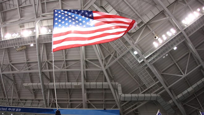 A fan of team United States waves an American flag during the game against Czech Republic during the Olympics in South Korea.