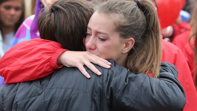 Friends and family member of slain IU student Hannah Wilson are overcome with emotion during a vigil at the Indiana Elite cheerleading academy in Noblesville on April 25, 2015, in her memory. Hundreds of friends, cheer and gymnastic teammates joined family members of Wilson, 22, whose body was found early Friday in Brown County.