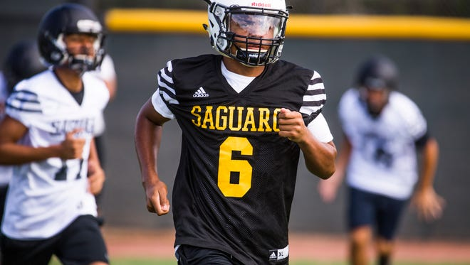 Saguaro High School wide receiver Jojo Patterson runs sprints at practice on Tuesday, July 25, 2017.