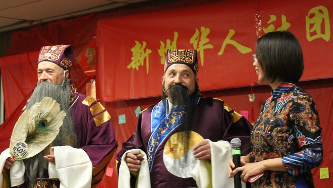 Belleville Historical Society President Michael Perrone, center, dressed in Chinese opera garb, glances at Joyce Chau, principal of Marlboro's Huaxia South Chinese School, while Historical Society volunteer Val Hadshinow of North Arlington looks into the crowd Sunday, Feb. 12, 2017 during a lunar new year festival in Belleville.